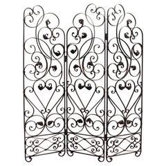 An Early 20th Century Ornate Wrought Iron Three Sided Screen