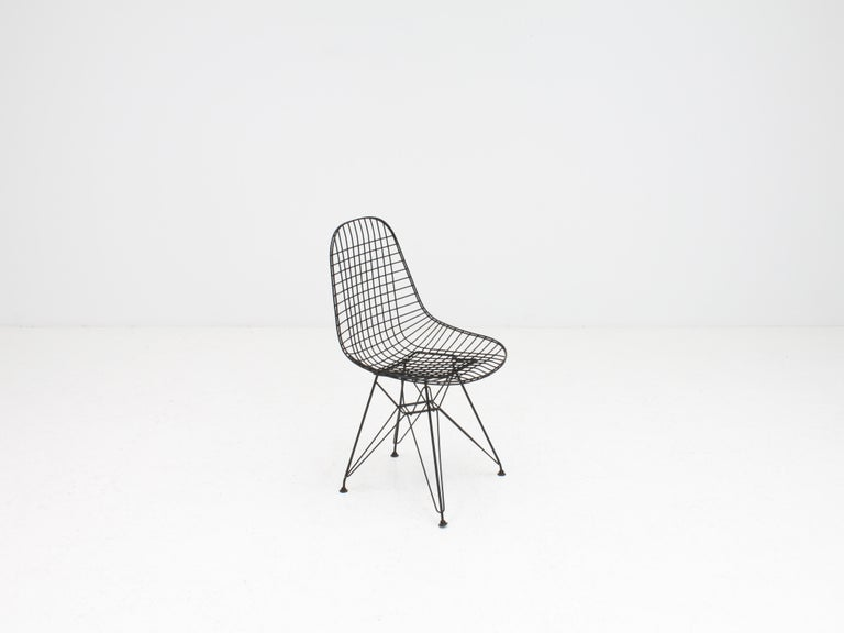 An early Charles & Ray Eames wire DKR chair with original vinyl cover, circa 1950s.  Featuring 'Eiffel' base.
