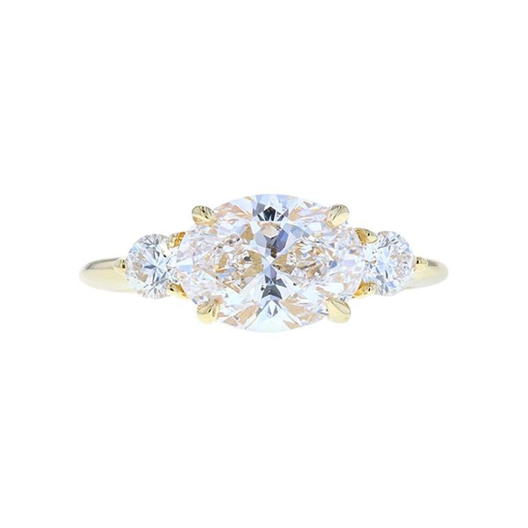 East West Oval Diamond Engagement Ring in a Three-Stone Setting