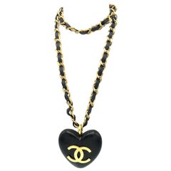 An Ebony Heart hangs on the iconic Chanel chain with leather sign. 1990
