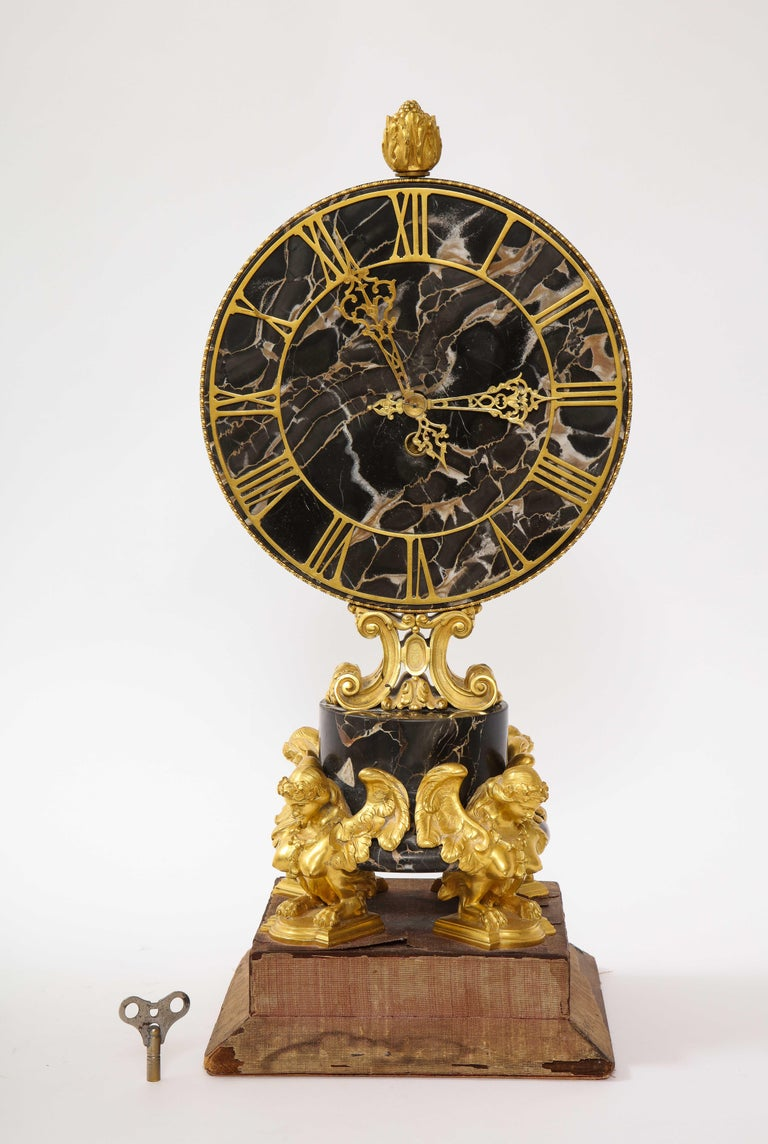 A gorgeous and large E.F. Caldwell black veined marble and dore bronze mounted sphinx legged clock. This is a beautiful mantle clock designed by the great, E.F. Caldwell and Co. The face and mid-section are made of a beautiful hand carved veined