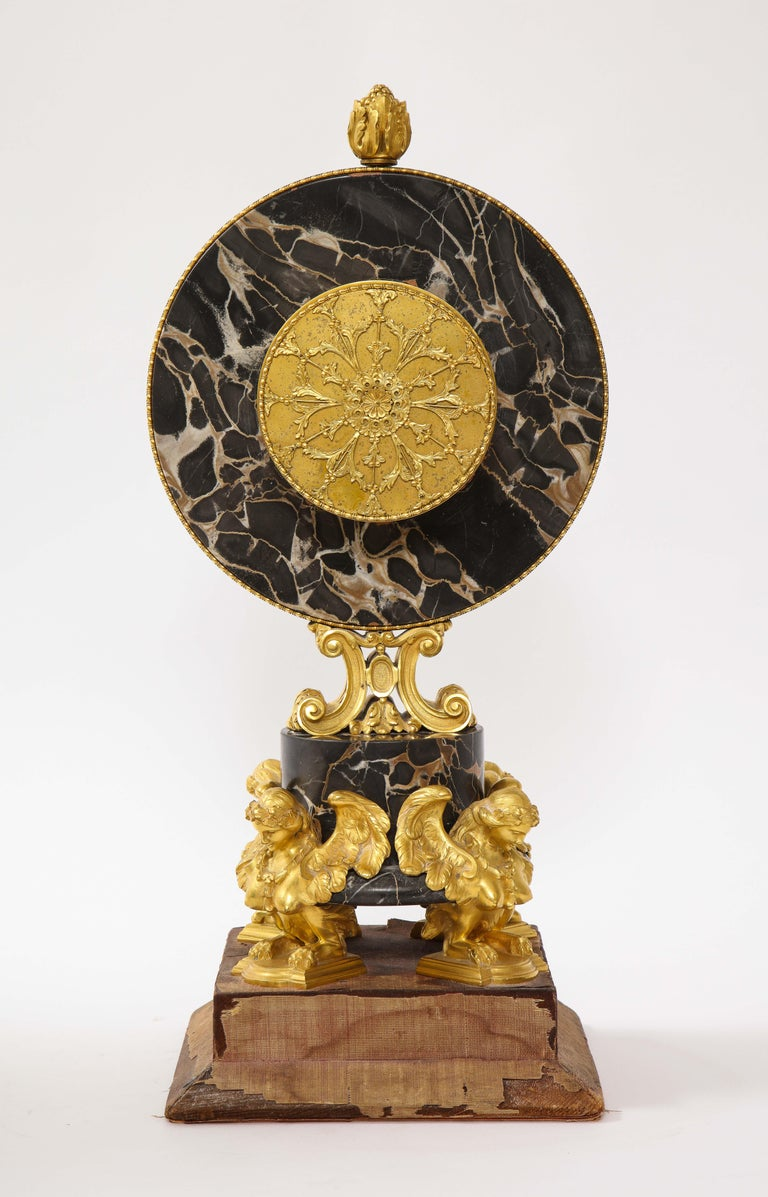 Early 20th Century E.F. Caldwell Veined Black Marble and Dore Bronze Mounted Sphinx Legged Clock For Sale