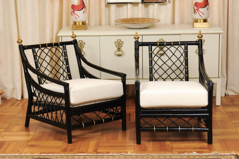 An exquisite restored pair of Throne style lounge or club chairs by Willow and Reed, circa 1955. Exceptionally crafted hardwood and rattan construction with lovely lattice detail. Beautiful finials accent the chair back. Incredible design, execution
