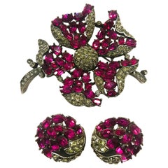 An elegant ruby and grey paste brooch and earrings, A Philippe for Trifari 1950s