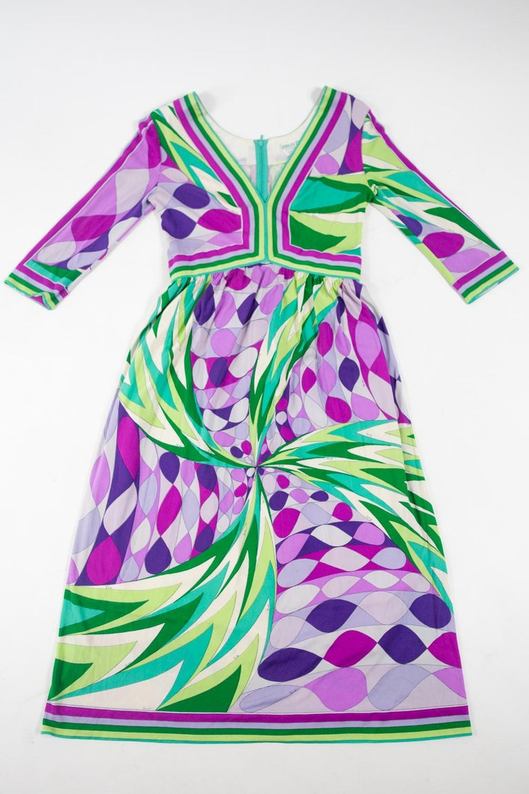 Circa 1970/1980 Italy Iconic dress by Emilio Pucci in printed silk jersey by the famous Florentine designer and dating from the 1970s. These dots and zig-zag patterns with a draped effect in shades of green, pink and purple, with Pucci's signature