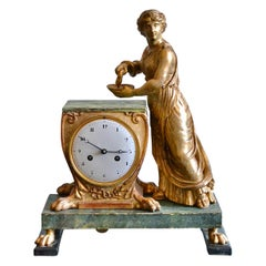 A Russian Empire Carved Gilt Wood and Faux Malachite Painted Mantel Clock