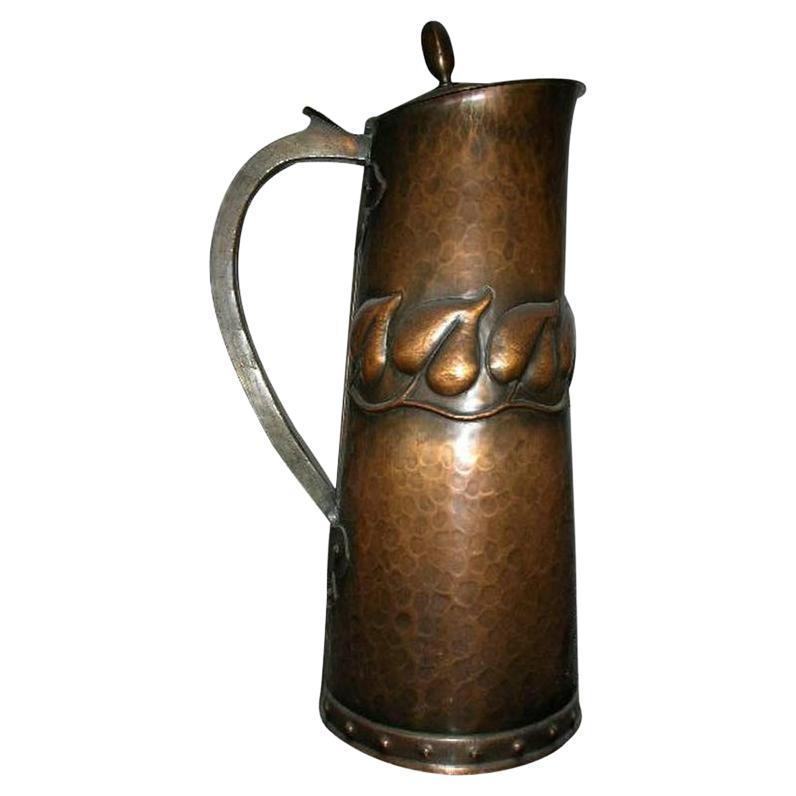 English Arts & Crafts Copper Jug with Stylised Hand Formed Leaf Decoration