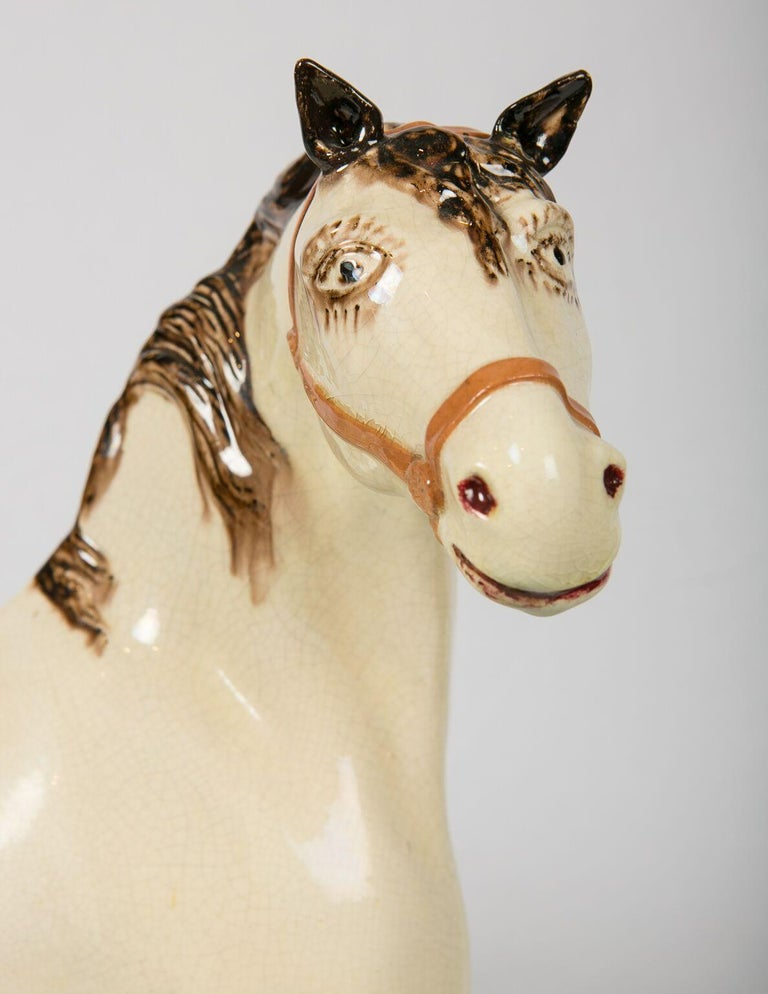 WHY WE LOVE IT: Always wanted one these. We're thrilled to have found it. We are delighted to offer this late Leeds Pottery stallion. He has a wonderful face with beautiful eyes. Large creamware enamel-painted horses are rare. The largest of the