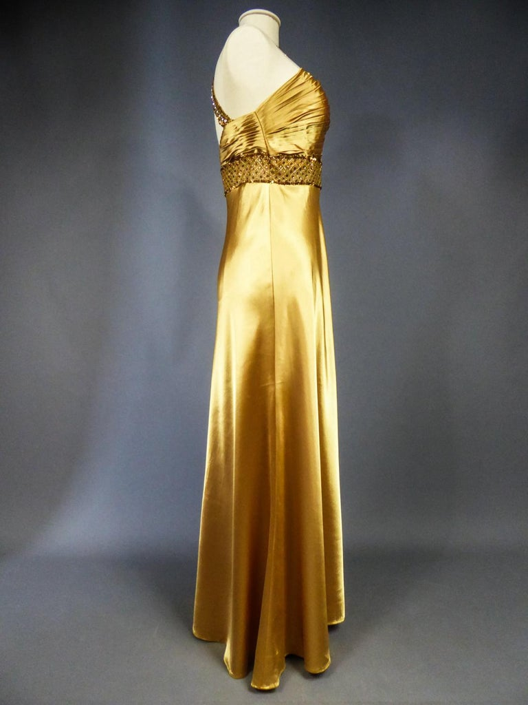 An French Evening Gown in Gold Embroidered Satin with Sequins Circa 1980 For Sale 5