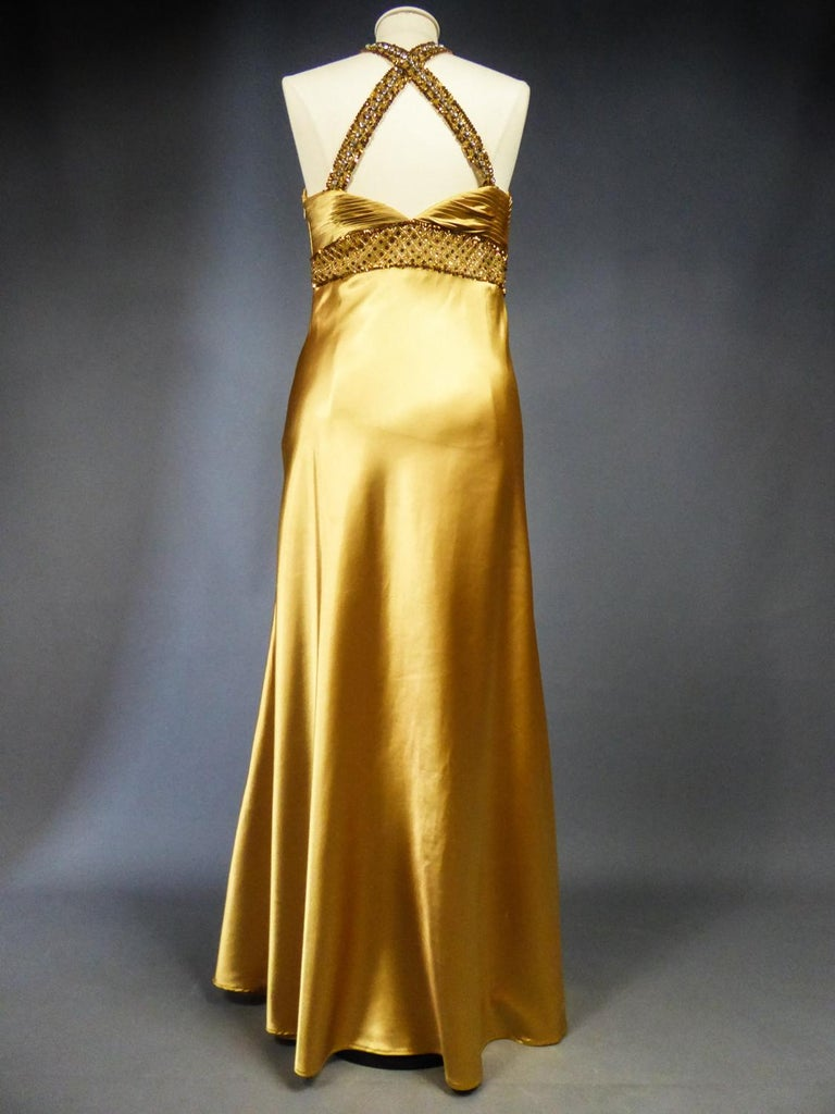 An French Evening Gown in Gold Embroidered Satin with Sequins Circa 1980 For Sale 7