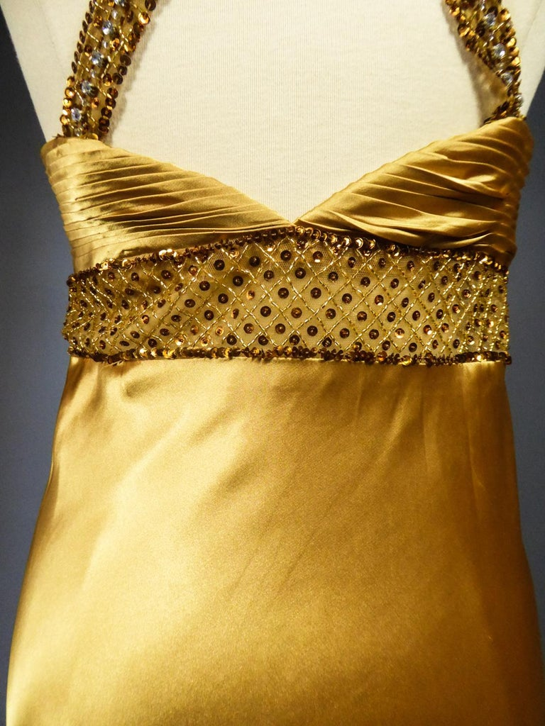 An French Evening Gown in Gold Embroidered Satin with Sequins Circa 1980 For Sale 10