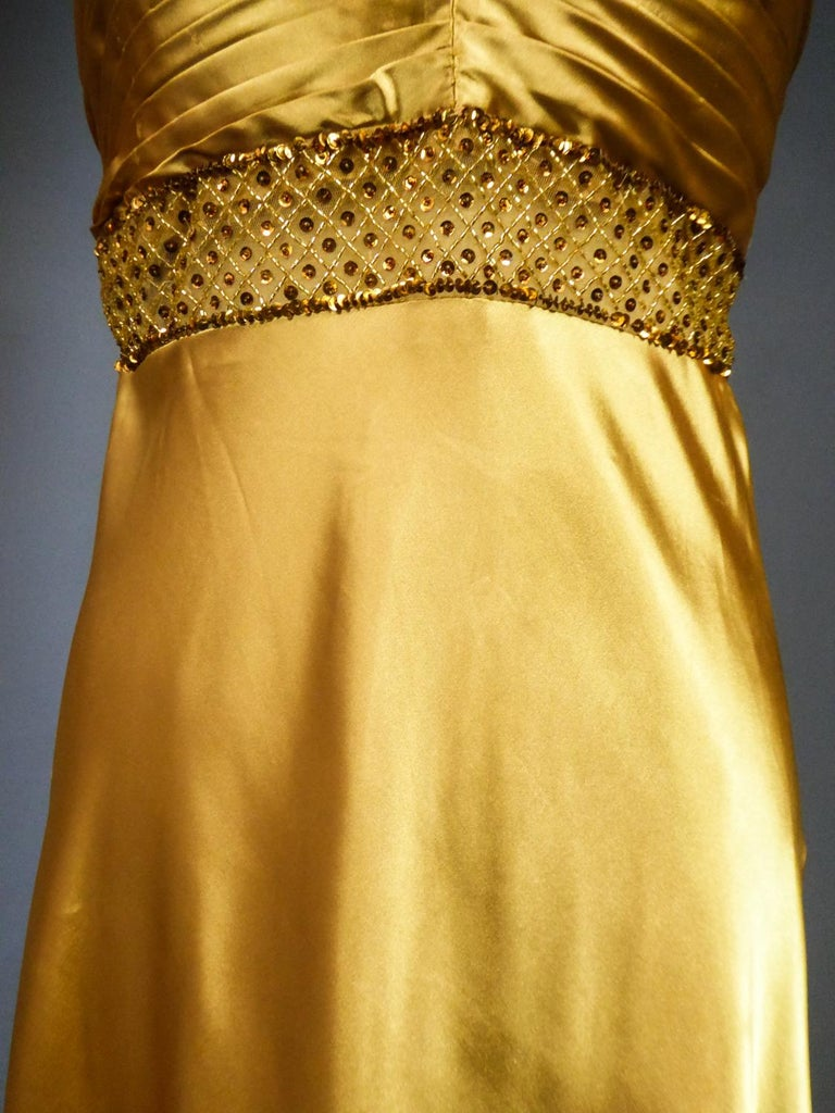 An French Evening Gown in Gold Embroidered Satin with Sequins Circa 1980 For Sale 1