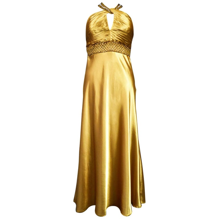 An French Evening Gown in Gold Embroidered Satin with Sequins Circa 1980 For Sale