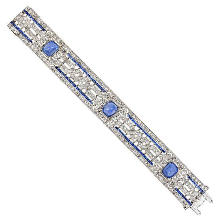 An important Art Deco sapphire and diamond bracelet, the three sugarloaf sapphires estimated to weigh 20 carats in total, accompanied by GCS report stating to be of Sri Lankan origin with no indication of heating, rub-over set to openwork mount of