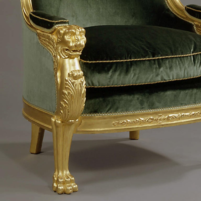 French Important Pair of Empire Style Carved Giltwood Tub Chairs, circa 1850 For Sale