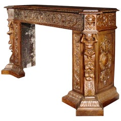 Impressive and Important Large Scaled Heavily Carved Walnut Mantel
