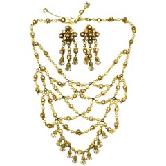 An impressive 'festoon' necklace and matching earrings, Christian Dior, c. 1954.