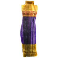 An Issey Miyaké Pleats Please Dress Champagne Collection 2008