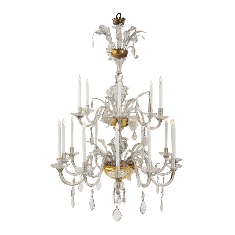 A sensational and large scaled Italian, 18th century glass and gilt eighteen light Tuscan chandelier. The chandelier has two levels of light with a most impressive cut glass gilt bowl above a hand blown glass sphere and circular saucer with kite