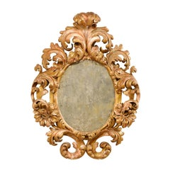 Italian 18th Century Richly Carved Acanthus Leaf Giltwood Antiqued Mirror