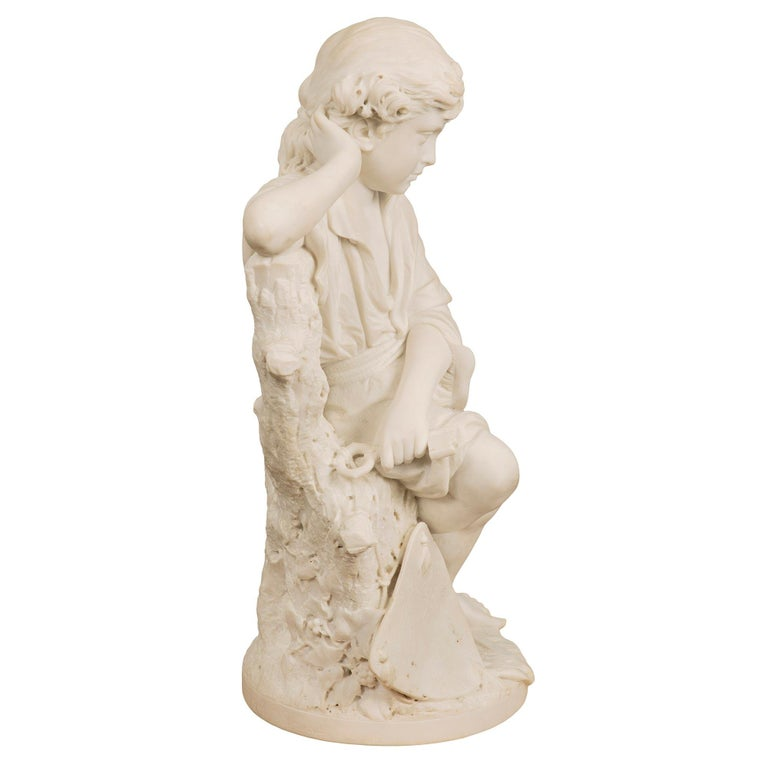 A very high quality Italian 19th century white Carrara marble statue of a young Benjamin Franklin, with a kite tied to a key, signed P. Bazzanti, Florence. The statue is raised by a circular base where the signature is displayed. The masterfully