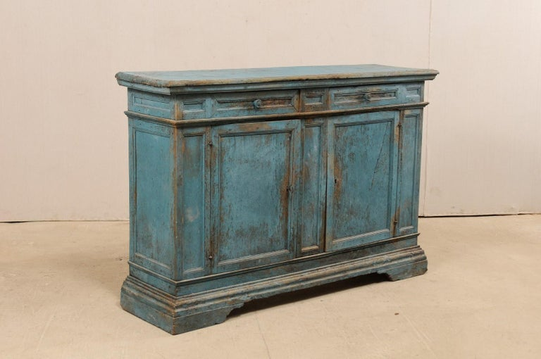 An Italian painted wood buffet cabinet from the 19th century, with later additions. This antique storage cabinet from Italy features a slightly overhanging rectangular-shaped top, above a case with two smaller sized drawers set horizontally at top,