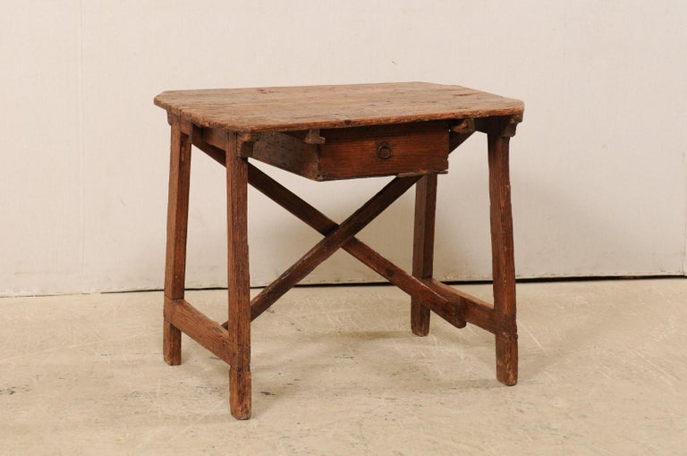 An Italian smaller-sized wooden work bench table with drawer from the 19th century. These cute little antique tables from Italy, often referred to as a