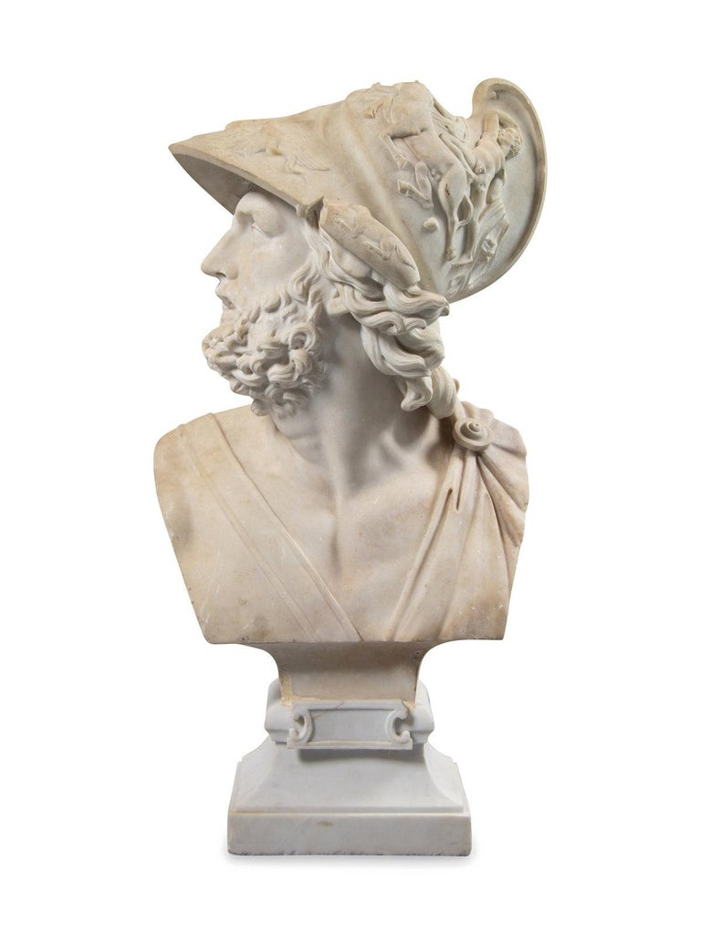 A magnificent Carrara marble bust of Ajax. Exquisite rendering of the Greek hero featuring elaborate helmet. On an associated square base.  After Gian Lorenzo Bernini (Italian, 1598-1680), circa 1880 Measures: Height 37 1/2 inches Width 19 inches