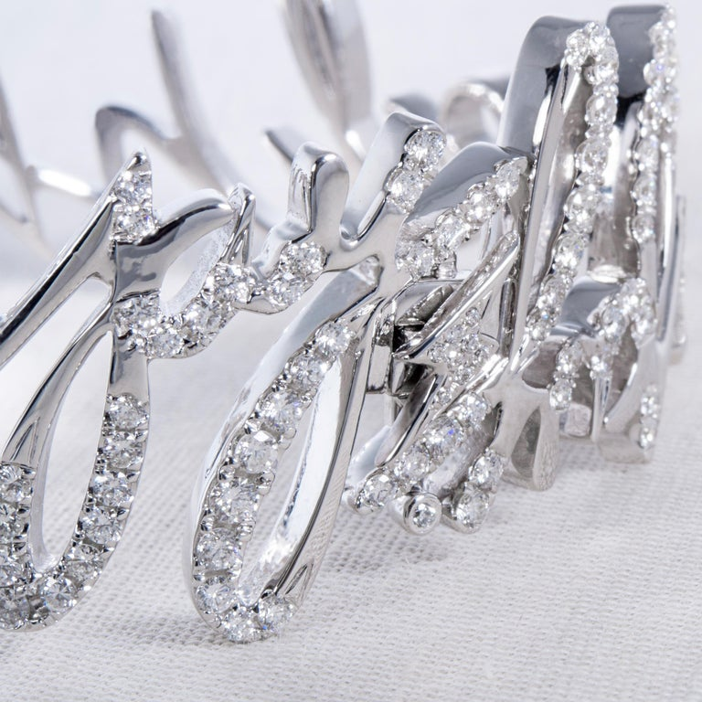 """An Order of Bling writes with Diamonds and creates the """"Yippiekiyay"""" Bangle  Collection: Writing with Diamonds  Title:  Yippiekiyay Diamond Bangle Diamonds, 3.08ct 18K White  Gold  Inspiration: Designed for the Die Hard Movie Series ultimate fan,"""