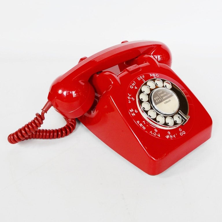 An original red lacquered GPO model 706L telephone. Bell control switch at front.  Dimensions: H 14.5cm, W 10cm, D 22cm  Origin: English  Date: circa 1960  Item No: 1102014  All of our telephones are fully refurbished, re-wired and in full