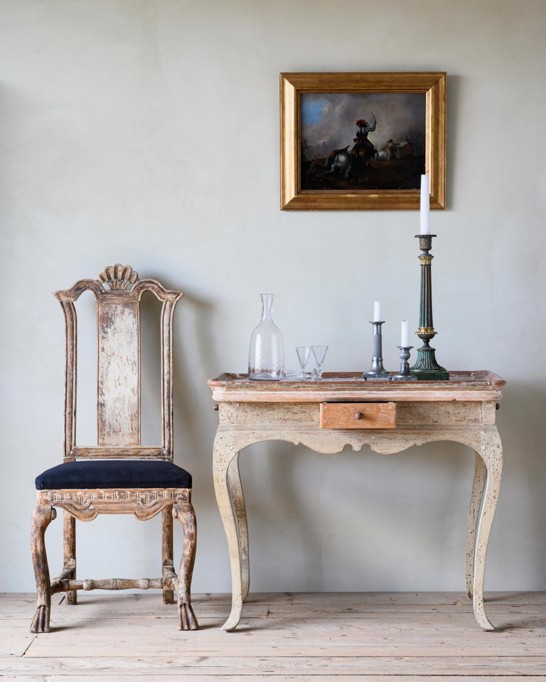 An unusual and delightful 18th century Rococo tile center tray table, circa 1780, Denmark.  Dry scraped to reveal its original colors. Contains four small drawers on each side of the table, works as a center table as well as a console table.