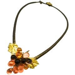 An unusual coloured glass and gilt metal 'grape' necklace, France, 1920s.