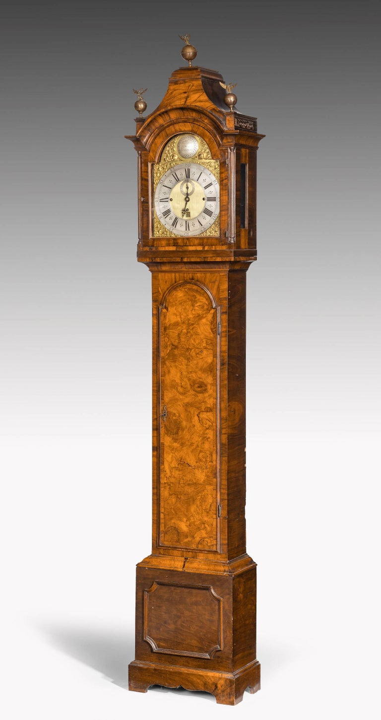 An unusual longcase clock in a fine but very retrained walnut frame and a hooded top. The name William Harris engraved on the plate. Harris was active in the second and third quarters of the 18th century in London.  The whole of the mechanism has