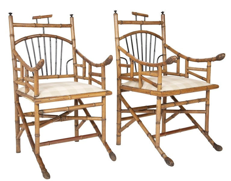 Pair of late 19th century English bamboo armchairs with ebonized spindles and intricate bases.