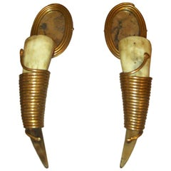 """An unusual pair of """"horn"""" sconces with mirrored backs"""