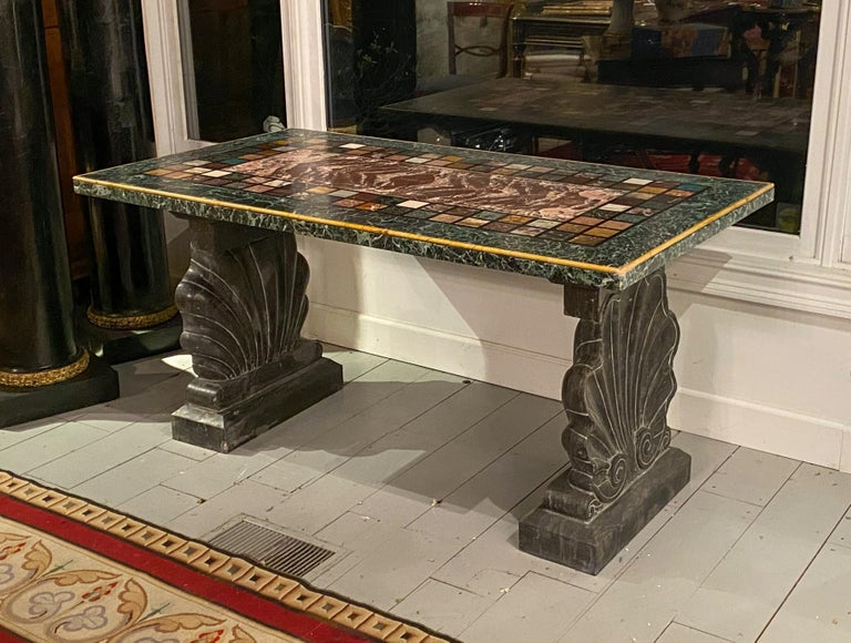 """An unusual """"Specimen Petra Dura"""" marble top table Resting on very rare shell form support bases Possibly Florence, Italy 19th century  Measures: Height 31 in, width 61 in, depth 33 ½ in.  Provenance: Private Collection Palm Beach, FL."""