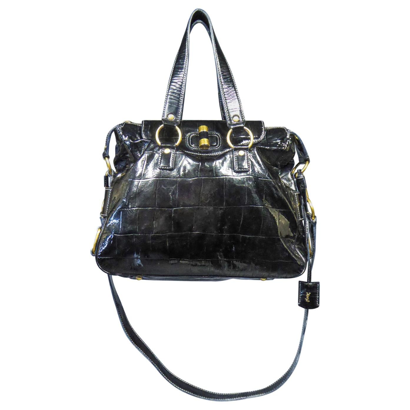 An Yves Saint Laurent Rive Gauche Bag in Black Patent VinylCirca 1990