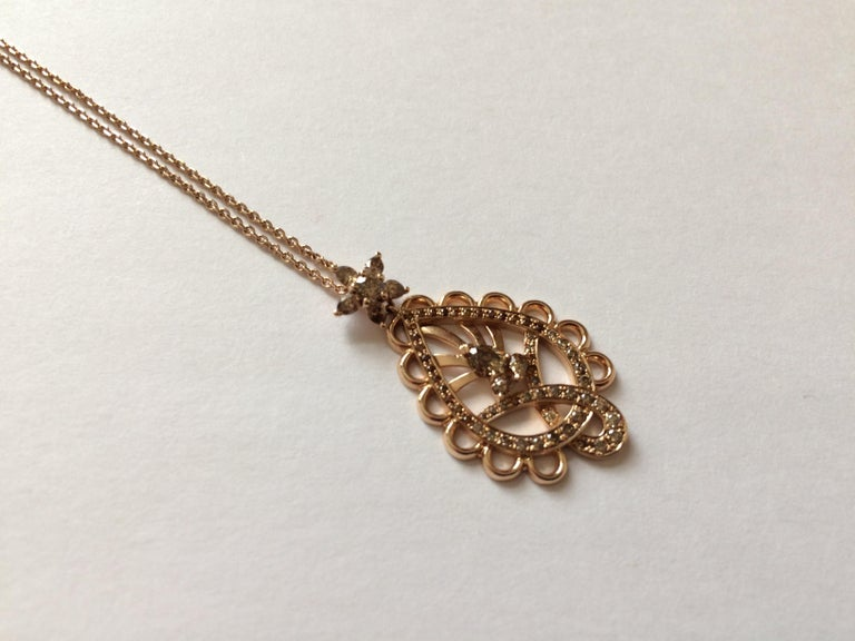 This pendant is handcrafted from 18ct rose gold and set with natural cognac diamonds which total 1.25ct. These stones were hand cut, specifically for this piece.   Diameter of pendant: 2cm Length of pendant: 3.5cm  The chain is 41cm long or 16