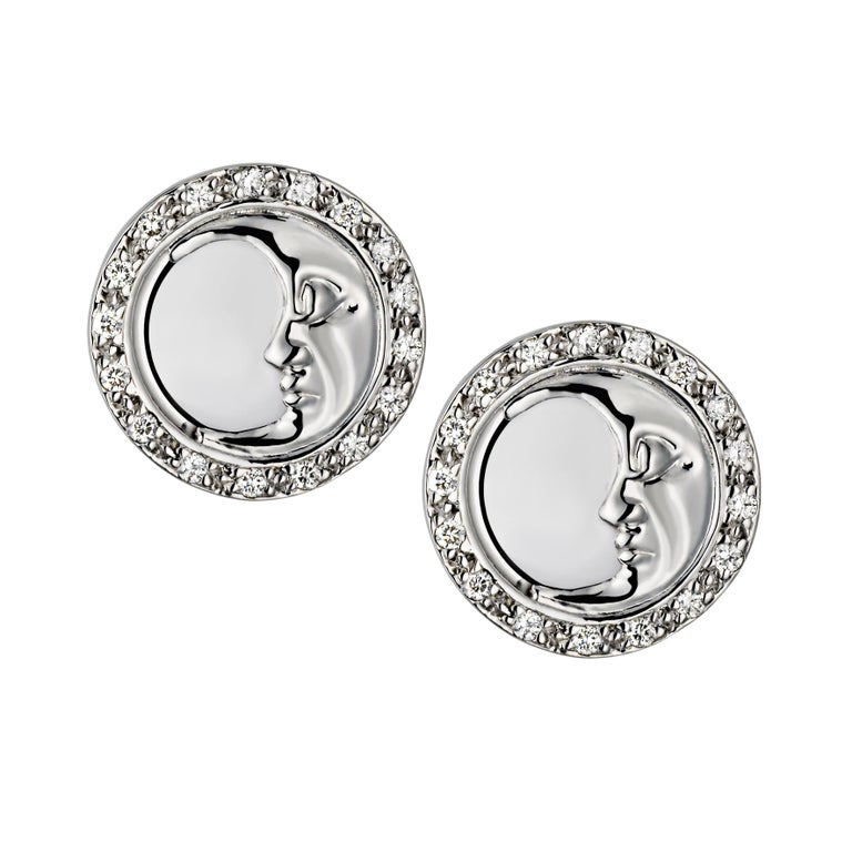 The sun and moon studs sits on the ear and are each pave set with 0.15ct of diamonds,weighing 0.30ct in total. The moon stud is pave set with white diamonds to represent the night sky and the sun stud is pave set with natural canary yellow diamonds
