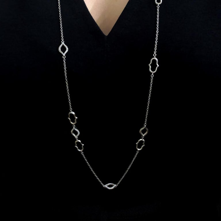 Motif Link Necklace handcrafted by jewelry artist Anahita in matte-finished 18k white gold with six double-sided elements embedded with round brilliant-cut white diamonds. 38 inches.