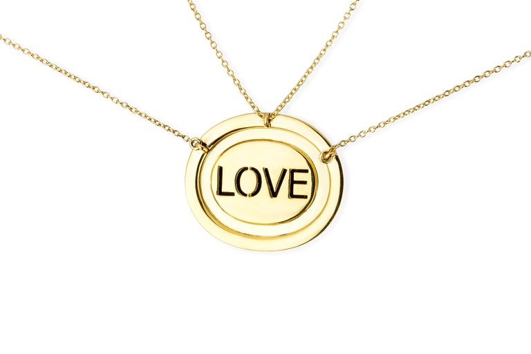 The blue agate cameo is hand created by a master carver bringing out the colors and depth within the layers of the stone. The cameo is encased in yellow gold, inverted diamonds, and sapphires. On each Eye Love Mini Cameo necklace, 'love' is found on