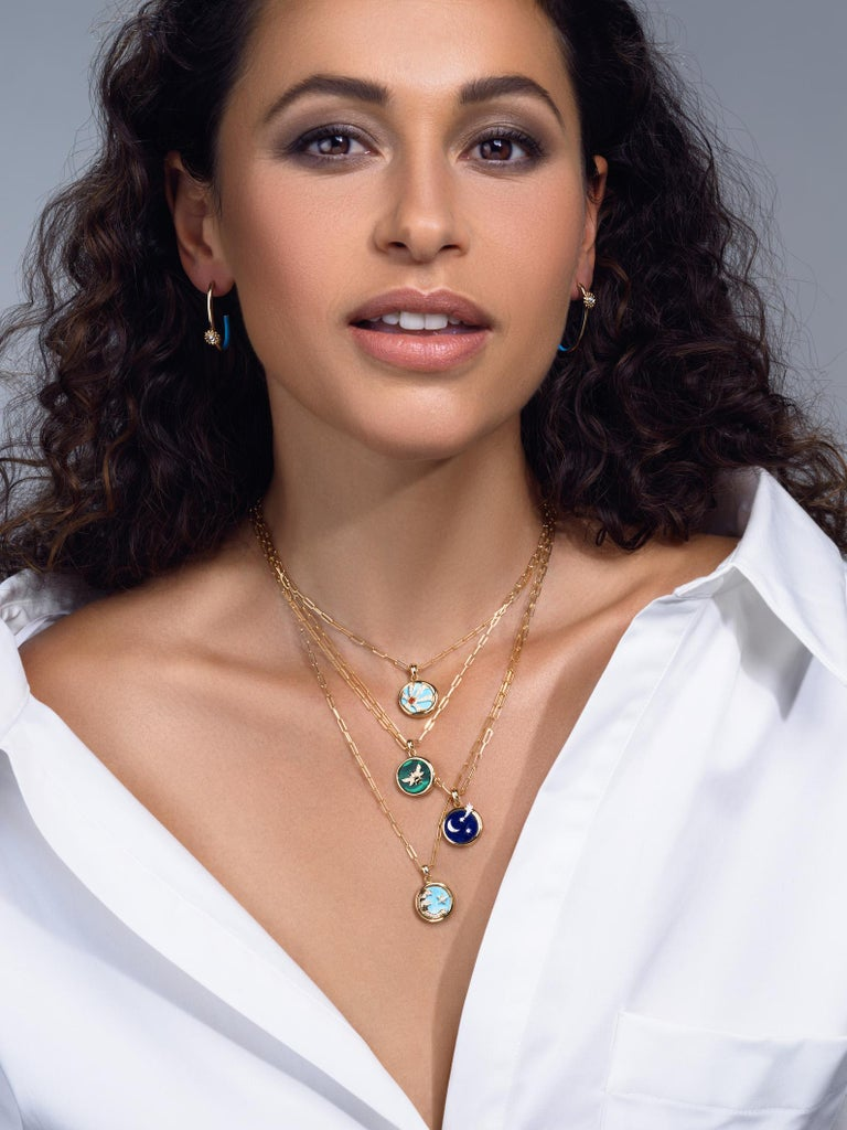 The Four Elements Air Pendant is a dazzling piece honoring both the visual and spiritual cosmos. A blue lapis lazuli ether is the background on which a luminous crescent moon and stars sparkle in yellow gold and pave diamonds. A radiant white gold