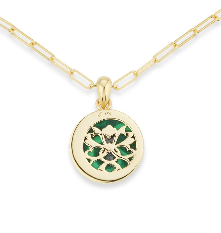 The Four Elements Earth Pendant is an expression of the abundance of our mother earth and reverence to the bumblebee. An 18k yellow gold bee, with ruby eyes, and black enamel stripes, is suspended over malachite.  This pendant decadently flips over,