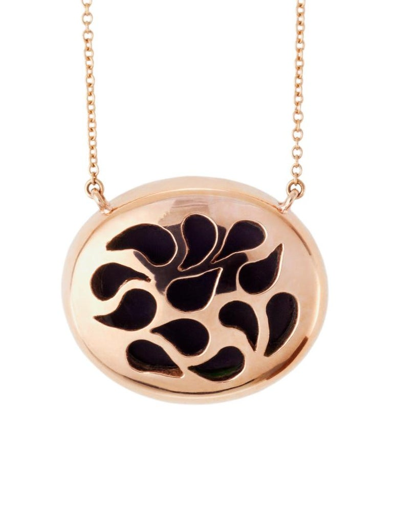 ONE-OF-A-KIND   The blue agate cameo is hand created by a master carver bringing out the colors and depth within the layers of the stone. The cameo is encased in rose gold surrounded by pink rubies all hanging from the rose gold chain. As in every
