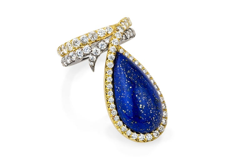 A one-of-a-kind piece inspired by the simple elegance of the blue and gold flakes embedded in the vintage Lapis Lazuli gem. A ribbon of sparkly diamonds set in 18k white and yellow gold gently follows the curve of the Lapis and the wearer's finger