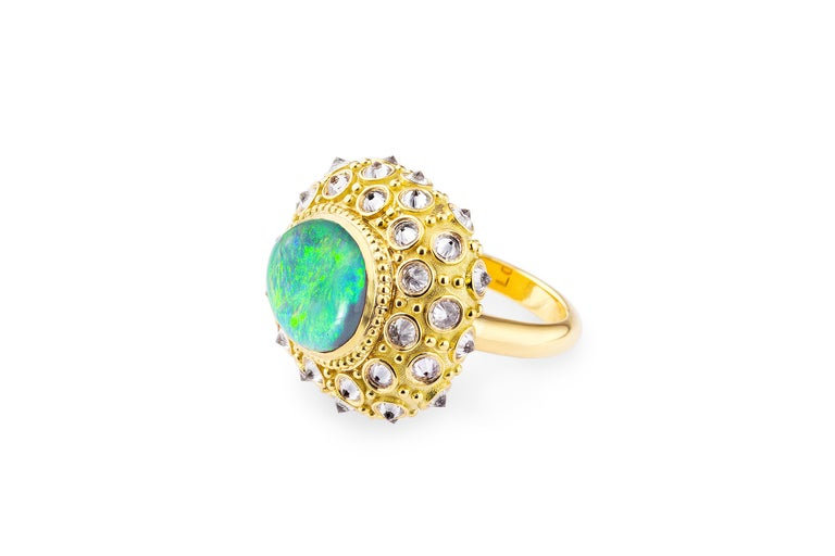 AnaKatarina's 'Beyond the Sea' 'Ring is an homage to the beautiful sea urchin and its totem of intuition and evolution. This beautiful work of art is one-of-a-kind. A Lighting Ridge black opal adorns the center of the sea urchin surrounded by
