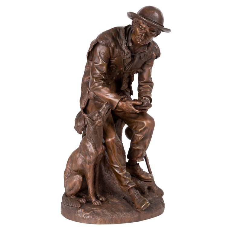 """Anatole J. Guillot Bronze Sculpture Depicting """"Seated woodcarver with dog"""" For Sale"""