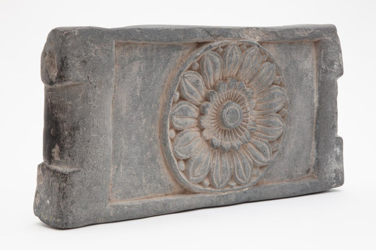 An exceptional and very early Buddhist stone altar equipped with two handgrips for moving it to the spot of the planned sacrifice. Carved by hand from a single block of schist between the 3rd and 6th century AD in the Aryan kingdom of Gandhara then