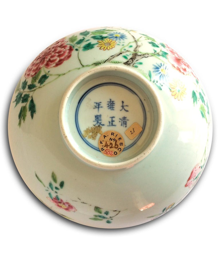 This imperial porcelain bowl shows a polychrome decoration, pink family: an elegant and auspicious floral motif such as peach blossom and peony.  At the base, the seal of Emperor Yongzheng (1723-1735), the fourth emperor of the Qing dynasty and the