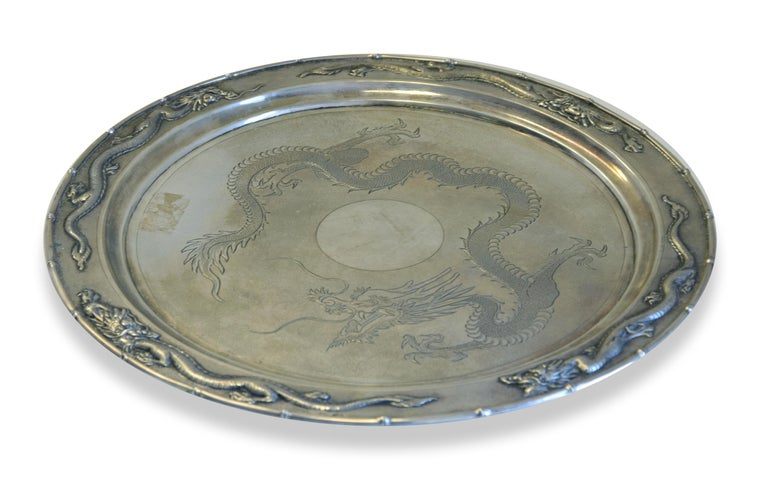 Chinese silver tray is an original decorative object realized in China between 1870 and 1930.  Original silver object.  Hallmark Shangai, silversmith Zee Wo.  Titled 800/1000.  Ø 35 cm   Mint conditions.  Precious Antique silver tray